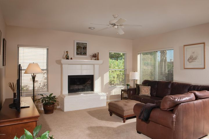 The family room has a charming raised hearth on the wood burning fireplace and is open to the kitchen.