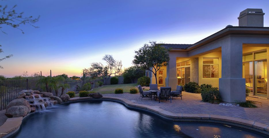 Private backyard with a 3 acres of natural space behind and city light views.