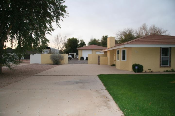 EXTENDED DRIVEWAY AND GARAGE THAT HAS UTILITIES, LIFTS, AND CAN ACCOMMODATE 8 VEHICLES, BOATS, OR ANY TOY THAT A MAN HAS