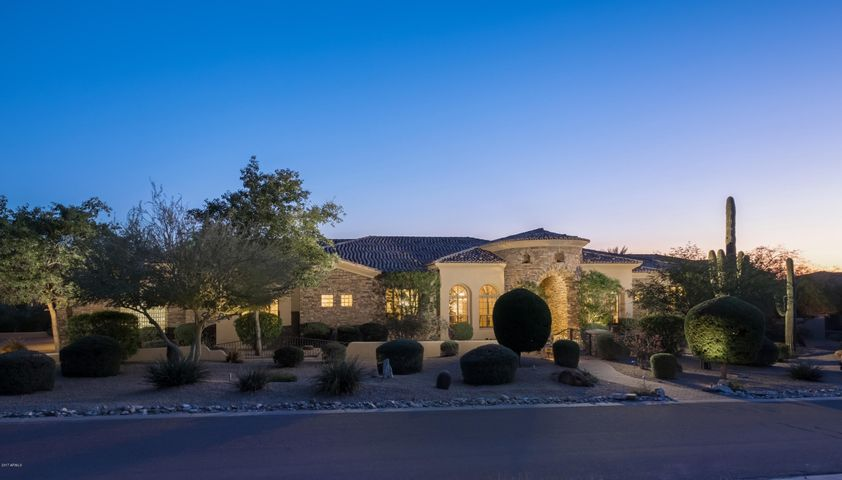 Absolutely gorgeous curb appeal...complete with an immaculate 4-car garage with storage and epoxy floor