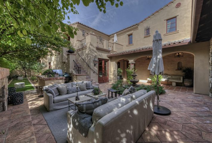 Stunning private & lushly landscaped courtyard.