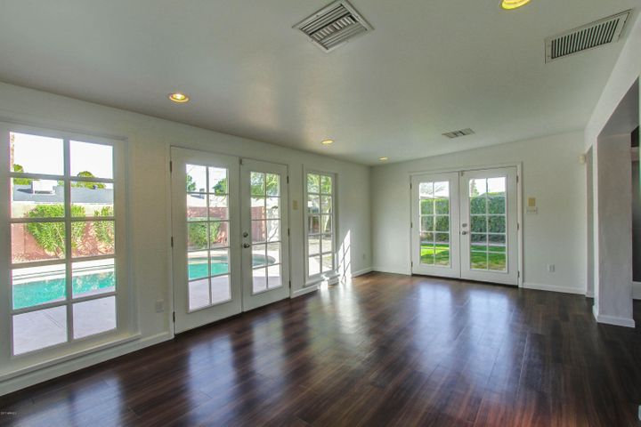 Light and bright with french doors that open to the pool