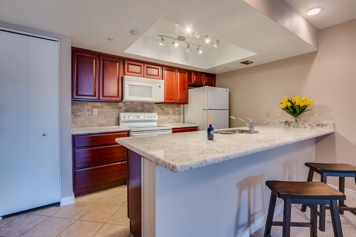 Immaculate kitchen with new granite counter tops, new backsplash, maple cabinets, built in microwave, large pantry and modern lighting