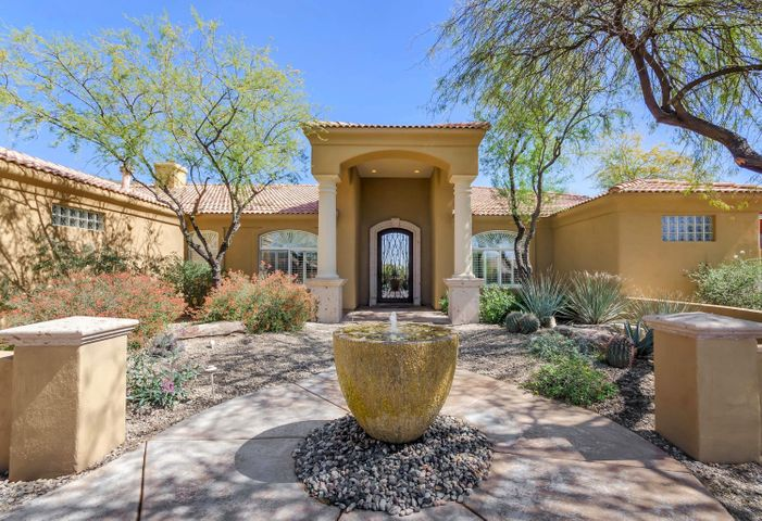Professionally landscaped front and backyard with built in water feature!