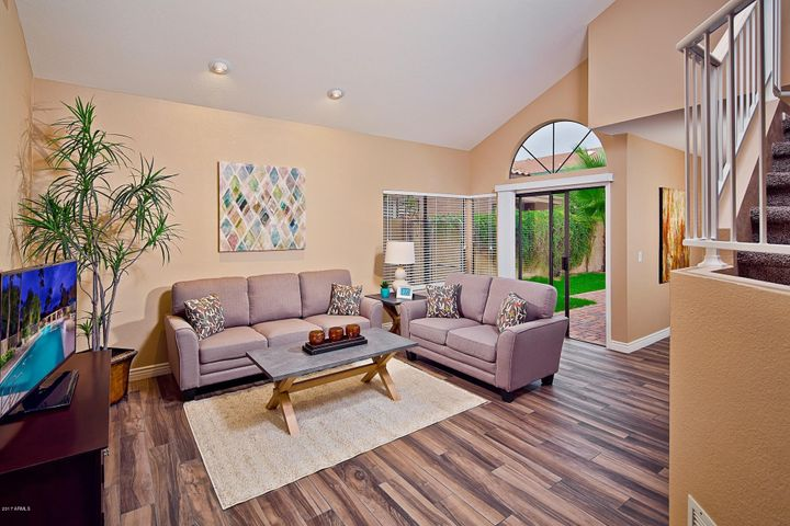 Spacious living room with high vaulted ceilings.