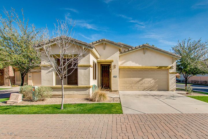 This lovely corner home backs to a beautiful greenbelt and gives you lots of privacy.