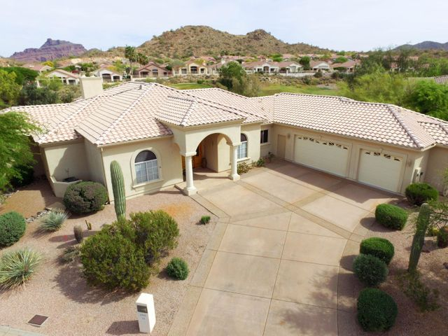 Its all about the Views! Red Mountain and Tonto National Forest mountains set the backdrop for this gorgeous custom home on the award winning Pete Dye golf course at Red Mountain Ranch.