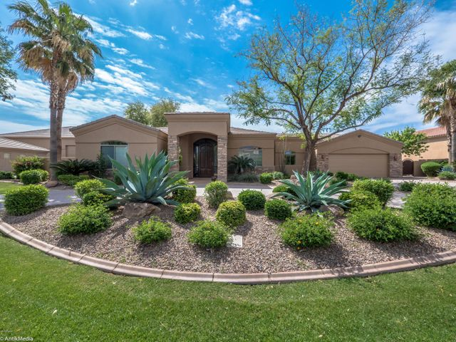Located on a quiet cul-de-sac inside the premiere gated community of Stellar Airpark Estates