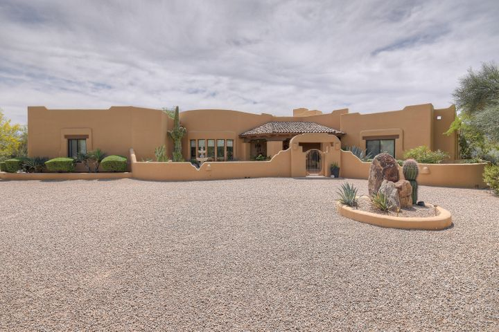 Situated on over 1+ acre lot in the award-winning guard gated community of Sincuidados. The main entry is from an open circular driveway into a private courtyard.
