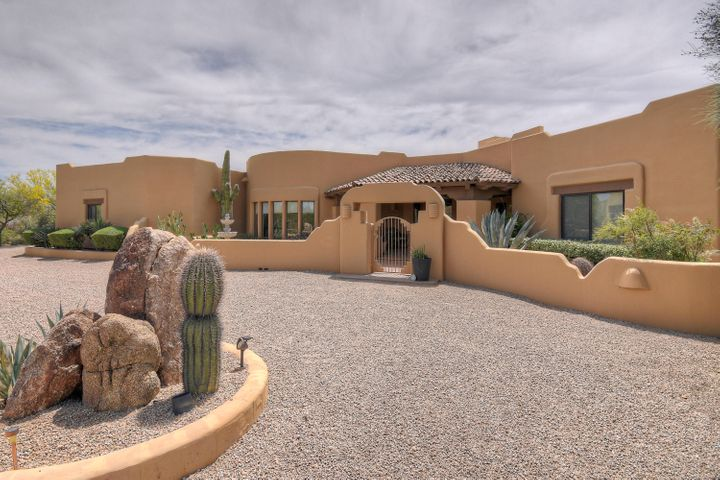 Spanning over 3943 SF, this magnificent residence graced by soaring ceilings and territorial style architecture is a haven for gazing at mountain views, desert and Arizona Sky. Owners have meticulously maintained their home and upgraded it multiple times. Upgrades include travertine & hardwood flooring, bathroom remodel, two nearly new HVAC units, built-in cabinets, new windows & much more.