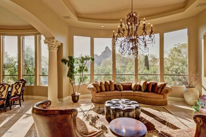 West side of home has Pinnacle Peak, City lights and sunset views.
