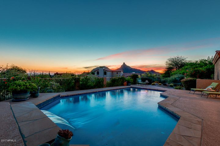A beautiful sunset view of Pinnacle Peak from your private backyard oasis.
