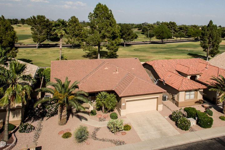 This lovely golf course home is located in the 55+ guard-gated resort community of Arizona Traditions!
