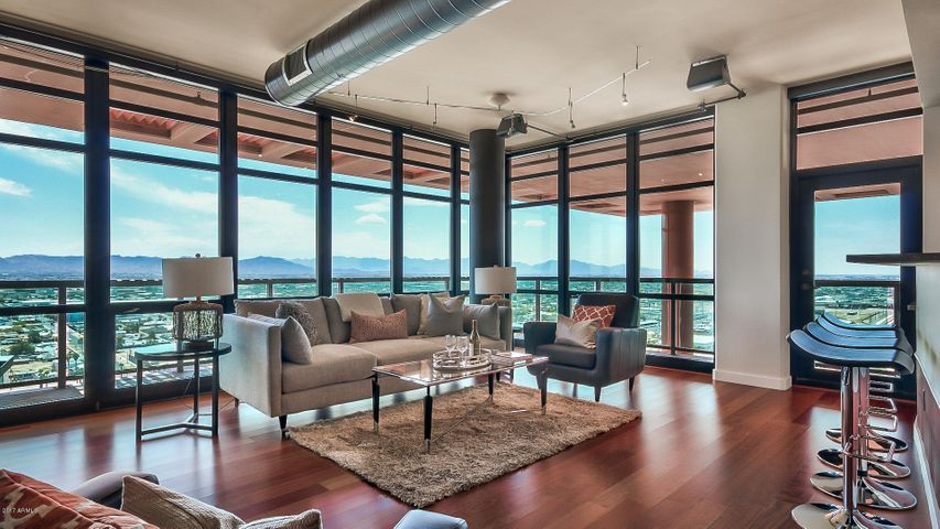 Want some fresh air? Walk out onto your 180-degree wrap around balcony. West, south, and east facing views.