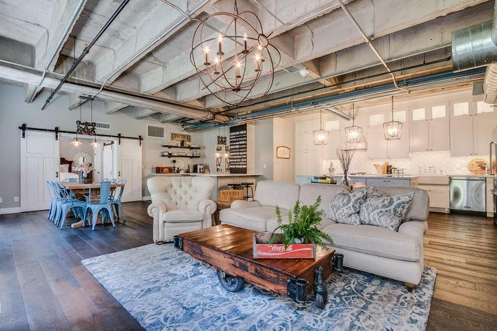 Restoration Hardware Masterpiece with hardwood flooring, exposed brick and ductwork, white shaker style cabinetry and amazing 1930's architecture.