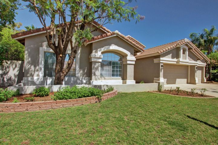 Beautiful Grass front with 3 car garage