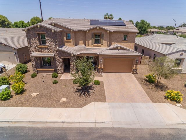 Awesome Higley Manor home with no neighbors behind you.