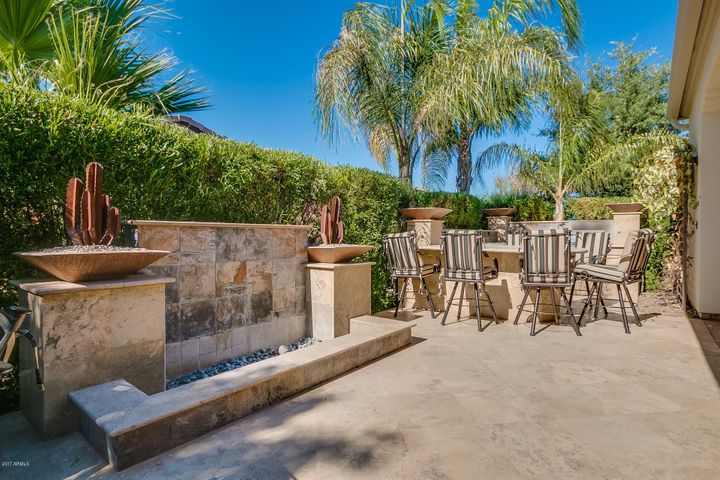 Exquisite back patio with fireplace, built-in BBQ, and fire features.