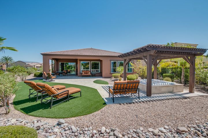 Desirable oversized back yard with built-in custom spa.