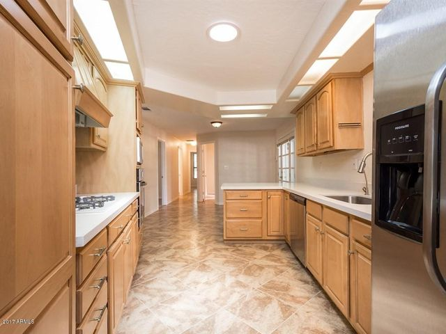 Artfully crafted cabinets and new quartz counters make this kitchen beautiful.