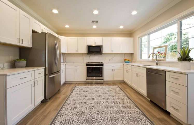 White Shaker Cabs with Quartz composite counters.