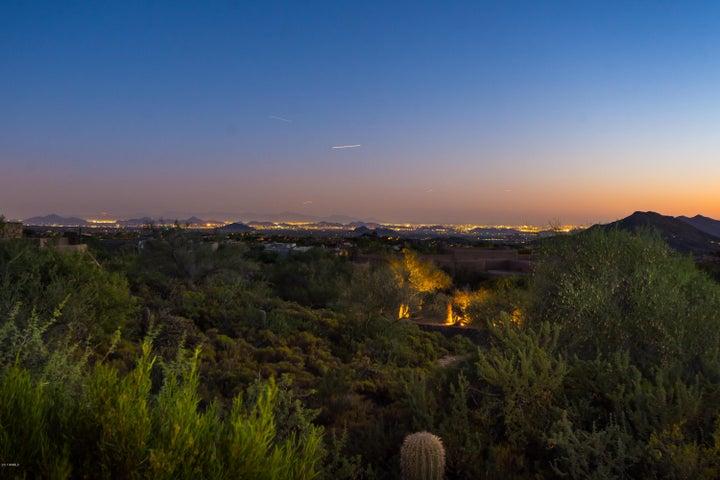 Set high above Scottsdale to enjoy the carpet of lights