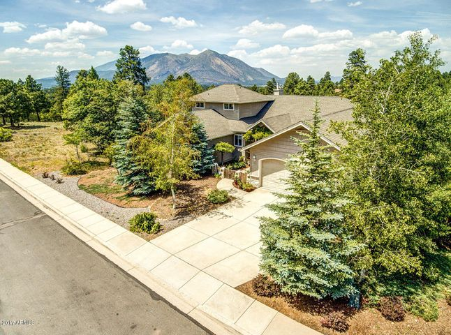 Wonderful Home in Desirable Amberwood With Views & An Elevator!