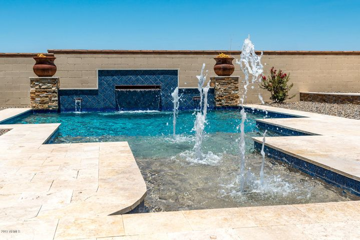 Salt Water Pool with wifi controls, LED color lighting, in-floor cleaning, quad DE filter and water feature.