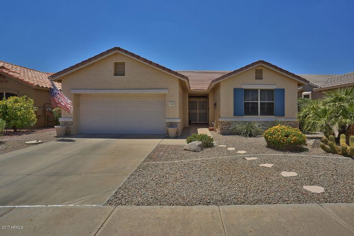 This lovely home is located in the guard-gated active adult resort community of Arizona Traditions.