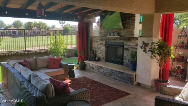 Outdoor living with golf and mountain views