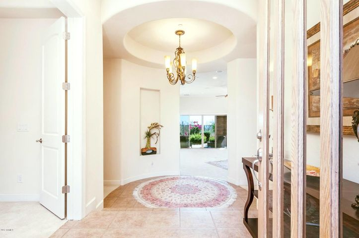 Two steps down from the open foyer, this area leads to just about every other space in the home.