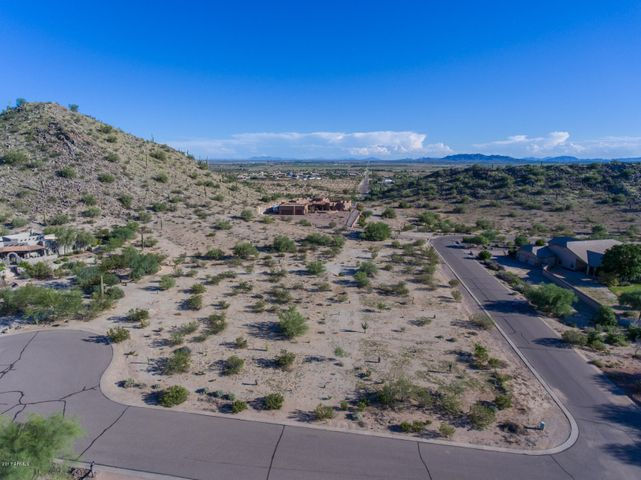 Highly sought after residential acreage in Las Montanas that sits on a premium hillside lot within a high end custom build community.