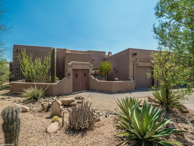 Nicely landscaped Southwestern home on spacious 1+ Acre homesite