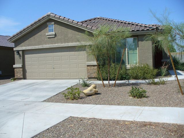 Easy care front yard on this north-south oriented lot.