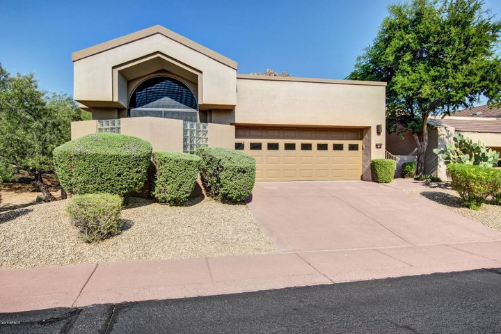 Highly sought after single level corner lot in Troon Village.