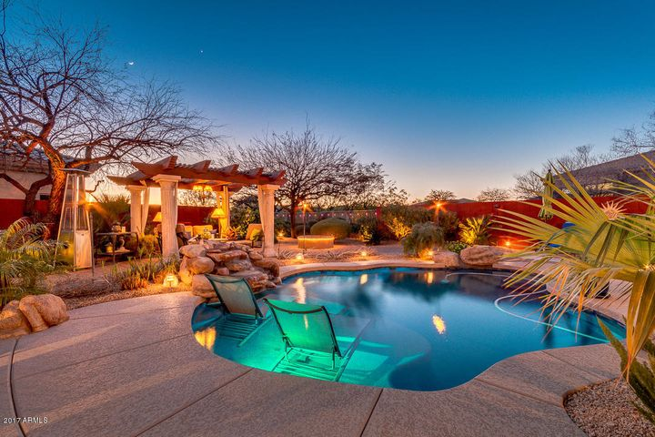 Private Backyard Oasis Pool with Waterfall and Therapeutic Jets