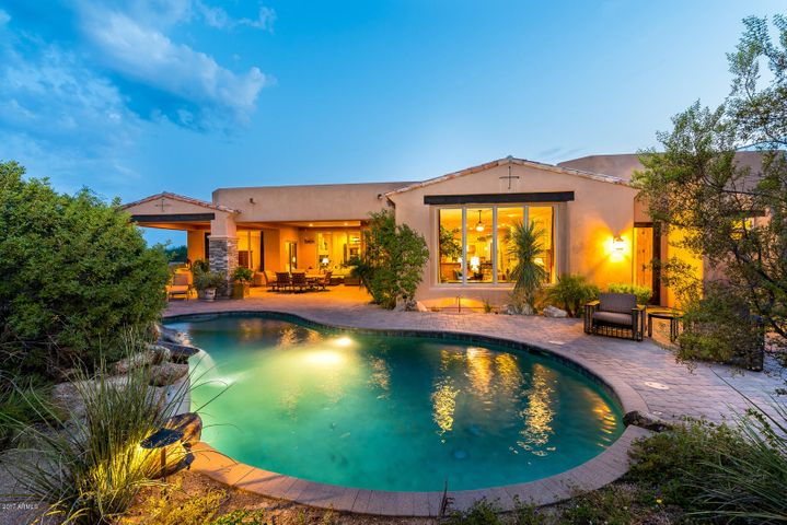 Enjoy the serenity and views from the resort style backyard complete with waterfall and spa.