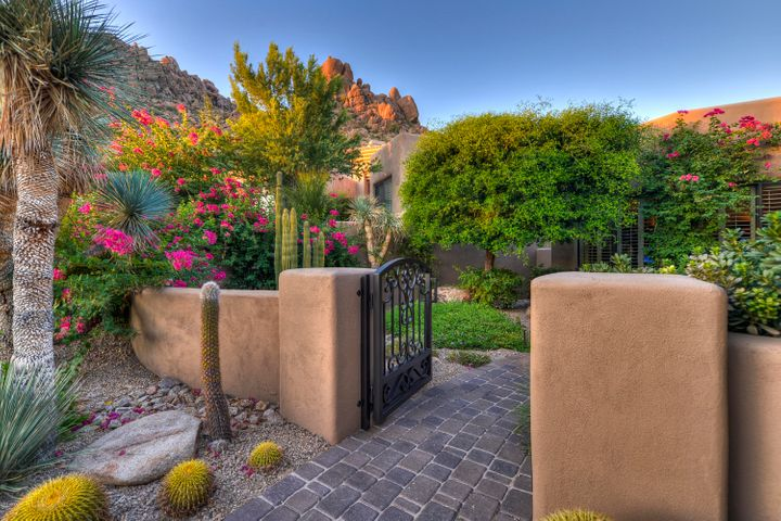 The Front Courtyard Entry is sure to create anticipation for what this home offers.