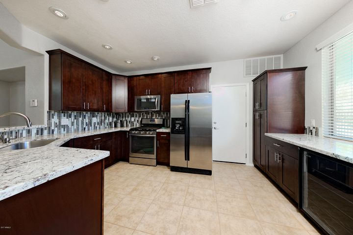 "Extended and remodeled kitchen with custom 42"" cabinets, Whirlpool Gold Stainless Steel Appliances, incl. gas. Whirlpool Gold Stainless Steel Appliances, incl. gas stove, $1500 Marvel Wine/ Beverage Fridge"