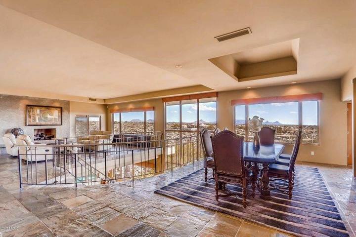 Gigantic Living and Dining space with 50 mile view panorama from Four Peaks to Carefree city lights. Perfect for entertaining.