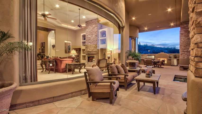 covered patio with soaring ceilings and impressive views.