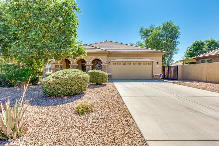 Lovely facade with desert landscaping and 2 car garage.