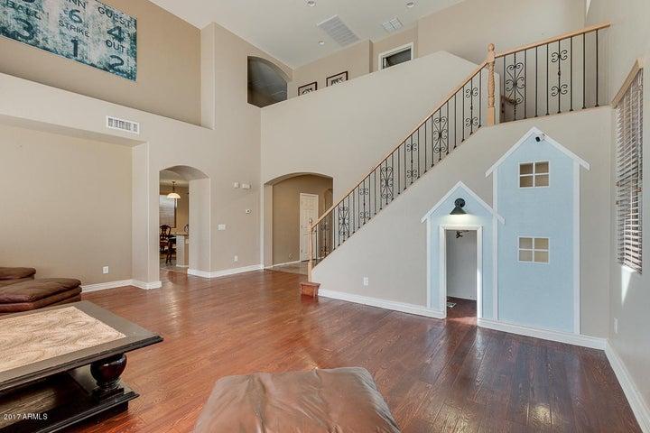 Custom built playhouse under the stairs.