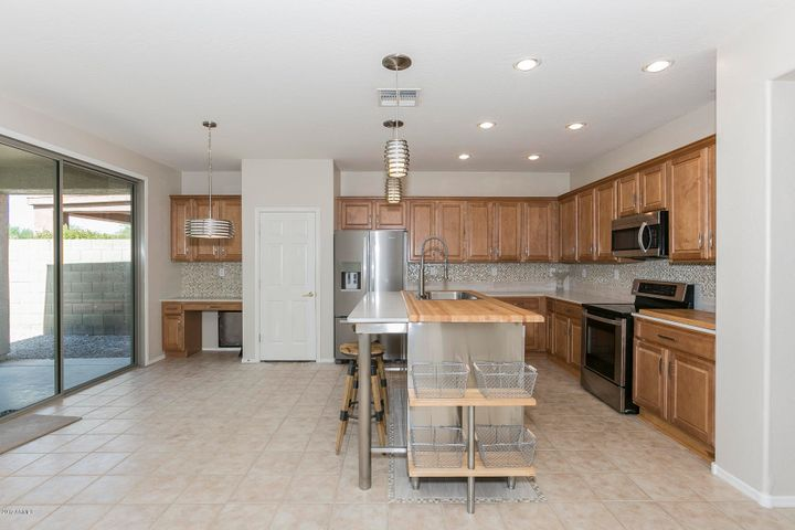 Remodeled Kitchen with Quartz Counters & Custom Butcher Block Island!