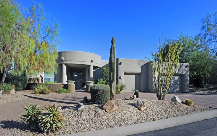 Custom home located in Sunridge Canyon with circular drive.