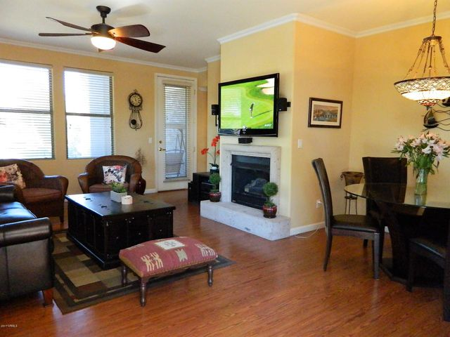 Single level condo with exit from family area overlooks well manicured grounds.