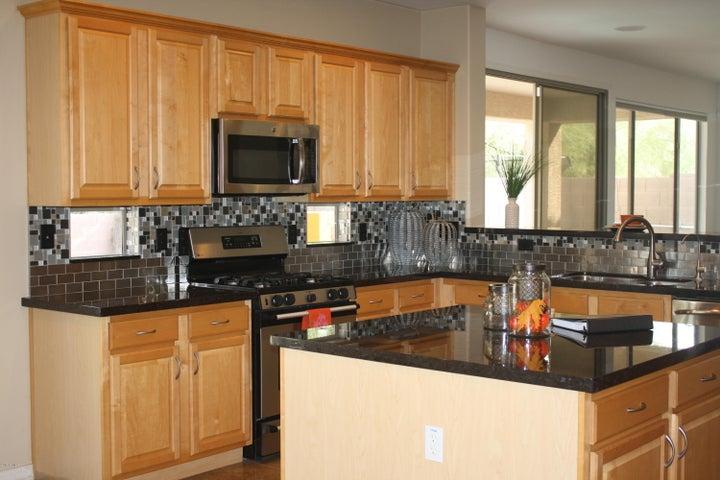 Gas Stove / Granite Countertops & Designer Backsplash