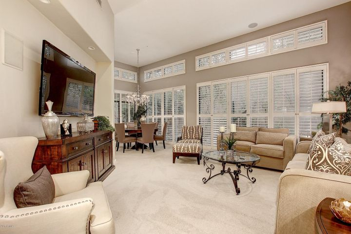 12 Foot Ceilings & plantation shutters bring the outside into the Living Rm