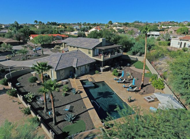 A massive private backyard ideally suited for reast, relaxation, recreation, or entertaining... Day AND Night!