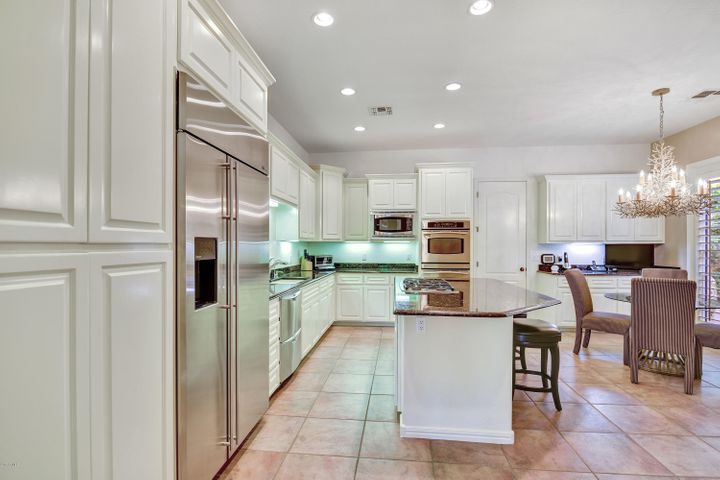 Center Island Stainless Steel Appliances, Pantry in this Chef's kitchen.